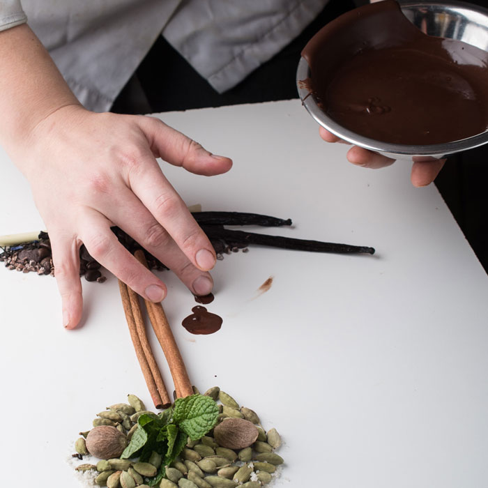 Hand drawing a ingredients composition with melt chocolate